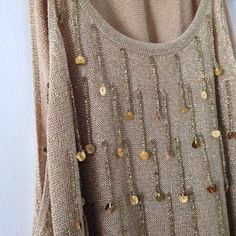 Shimmering Beaded Tunic Stunning gold beaded high neck tunic, 3rd photo shows a flaw with neckline. It's a sweater material and also has glass beads! No missing beads, tag says size 18/20 but fits more like a M Vintage Tops Tunics