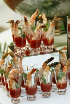 AMAZING shrimp cocktail shooters. Great passed appetizer idea! Or have the shooters displayed like shown here! SIMPLE BUT DELICIOUS. | Cafe Escadrille Weddings  #wedding #weddingreception #cafeescadrillefood #weddingvenue #onsitecatering #shrimpcocktail #shooters #cafeescadrille