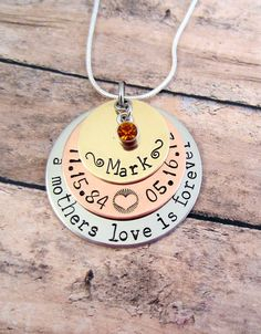 "Here is a similar necklace:  https://www.etsy.com/listing/217589916/loss-of-son-loss-of-daughter?ref=shop_home_feat_3    This is a great way to remember your loved ones. This necklace has ""A mothers love is forever"" stamped on the bottom stainless steel disc. The Copper disc is stamped with their life and death dates. The top disc is brass with your loved ones name stamped on it. It is finished with a small birth stone. The bottom stainless steel disc measures 1.25 inches, the middle copper…"