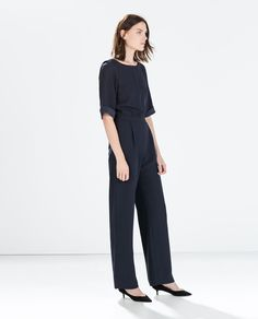 LONG JUMPSUIT WITH LOW BACK AND CHAIN DETAIL