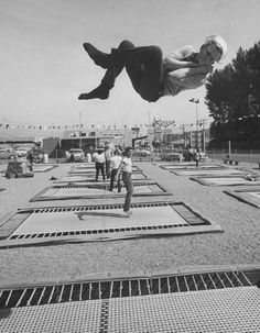 Ralph Crane, People Jumping on Trampolines, 1960