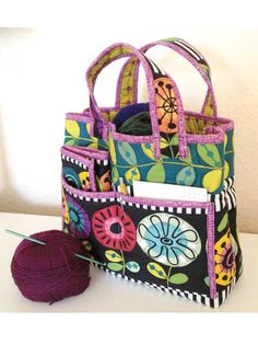 Crochet Caddy & Tote Quilt Pattern Download from e-PatternsCentral.com -- This quilted caddy-and-tote set was made for crocheters by a crocheter. The roomy tote holds yarn and books or patterns inside. Outside, the four pockets hold notebooks and other notions you want to keep handy.