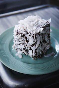 Lamington...an Australian dessert of sponge cake dipped in chocolate and coconut.
