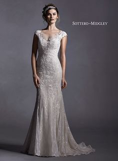 Lace and tulle sheath wedding dress with illusion neckline and plunging illusion back, Quinlynn by Sottero and Midgley.