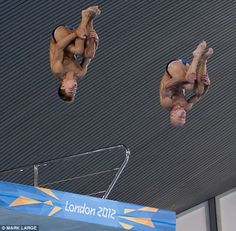 Making a splash: Team GB divers Tom Daley and Peter Waterfield practice in the Aquatics Centre
