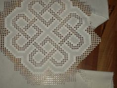 Cutting out my white on white Hardanger.