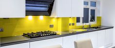 Yellow coloured glass kitchen splashback by CreoGlass Design (London,UK). CreoGlass™ Splashbacks are toughened and impact resistant. Glass can with stand temperatures up to 400℃. #kitchen