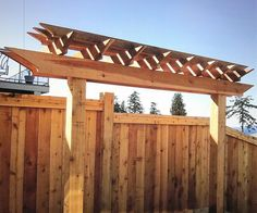 Beautifully balanced red cedar trellis designed and installed by our in house carpenter. Of course thats our trademark custom fence design as well Way to go K!