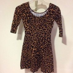Cheetah Print Skater Dress Used like new, only worn once, purchased at Macy's ....(The more you buy, the more I lower my prices so bundle & save!!) Macy's Dresses