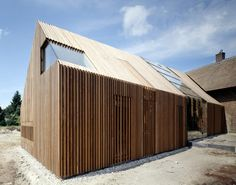 Farmhouse Conversion and Extension in Holland by SeARCH - nice 'chunky' cladding and frameless window