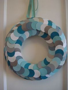 "Fell in love with this wreath and decided to make it in ice blues and winter greys. I used a 12"" styrofoam wreath form and a whole lotta 2"" cardstock circles. Very easy and looks super chic!"
