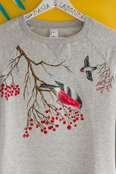 Items similar to Hand painted Gray Women Sweatshirt with birds, winter clothing, gift for her: Bullfinches and rowan on Etsy Fabric Paint Shirt, Paint Shirts, T Shirt Painting, How To Dye Fabric, Fabric Painting, Fabric Drawing, Embroidery On Clothes, Hand Work Embroidery, Embroidery Dress