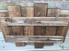 Rustic reclaimed pallet wood shelf
