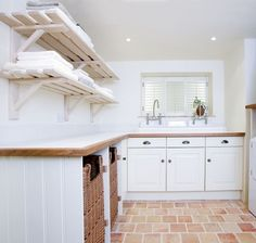 If space allows it, a dedicated laundry room or boot room is a wonderful asset to your home. Explore our utility rooms here. Laundry Room Shelves, Laundry Room Design, Laundry Baskets, Laundry Storage, Utility Room Storage, Laundry Room Lighting, White Laundry Rooms, Slatted Shelves, Kitchens And Bedrooms