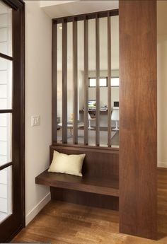 Modern entry - good use of a small space.  Built in floating bench.