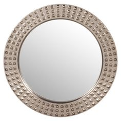 Add an artful touch to your master suite or parlor with this round wall mirror, showcasing studded detailing and a silver leaf finish.