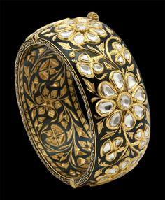 Black enameled with gold striking