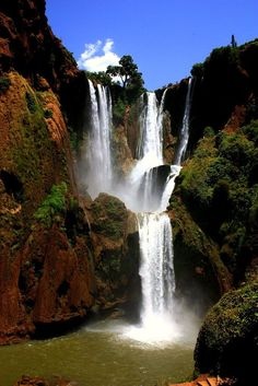 """Ouzoud Waterfalls, Morocco..,by Banklins The bottom of the falls is accessible through a shaded path of olive trees. At the summit of the falls, there are a dozen old small mills that are still in use. One can also follow a narrow and difficult track leading to the road of Beni Mellal. While descending the gorges from the """"wadi el-Abid"""" in a canyon sometimes one does not distinguish the bottom which is nearly 600 metres down."""