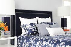 Florence Broadhurst quilt cover, velvet bedhead, Harper Lamps and white besides.