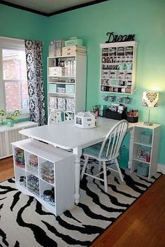 Like the idea of a table and separate bookshelves to organize craft supplies