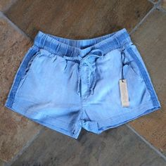 "🍃💗Denim Chambray Shorts Super soft and comfortable must have summer short in 100% Tencel easy care fabric. Features pull on styling with wide comfort stretch waistband and adjustable front cinch tie. Two slash hip pockets and faux fly front add thoughtful detailing. These chambray shorts are summer perfect in sought after bay wash rinse. Inseam measures approximately 2.5"". The cutest short shorts around! Quality throughout. Standard Anthro sizing. You will absolutely love the look, fit and…"