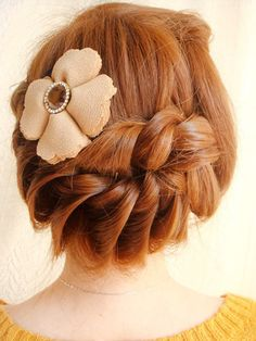 elegant twisted braid updo hairstyle with flower hair accessory
