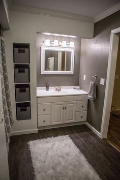 Our new bathroom.  Grey (Pewter Mug) and White walls! Flooring is vinyl plank from Menard's. Fabric baskets from The Home Depot. Bathroom Ideas!