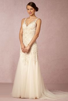 BHLDN. See more details about this dress from BHLDN��Intricate beading detail, sparkle buttons and weightless tulle make this gown bold yet elegant. Godet skirt and dramatic deep V-back.
