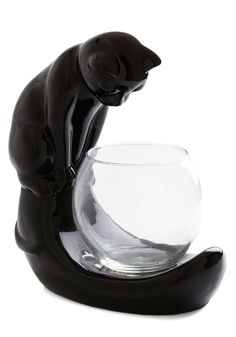 Curiouser and Curiouser Candle Holder. Youve seen your kitten watch over the fish bowl and bat at the faucet, but watching a candles flame flicker is a first! #black #modcloth