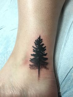 Faded pine tree tattoo by Miguel at 7th Street Tattoos in Little Rock, AR. Love my first tattoo!
