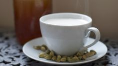 Warm milk is steeped with cardamom, with honey and vanilla added to sweeten and flavor it.