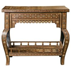 """An early 20th Century Middle Eastern mosaic side table inlaid with shells and bone. CIRCA DATA: 1st Quarter of 20th Century DIMENSIONS: 20.5"""" h x 23.5"""" w x 14.75"""" d PRICE: $2,900"""