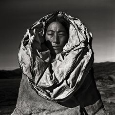 "From the series Wo Yong - The Earth ""When I first stood before the majestic mountains of the Tibetan highland, I realized the vulnerability of human beings. Although we each possess our own world, as the most intelligent creatures of this earth, we..."