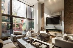 luxury NYC home cozy living room Expansive Home in New York City Adds Modern Renovation to Timeless Tradition Living Room With Fireplace, Cozy Living Rooms, Living Room Decor, Living Area, Bedroom Decor, Salons Cosy, Fireplace Design, Fireplace Ideas, Tv Fireplace