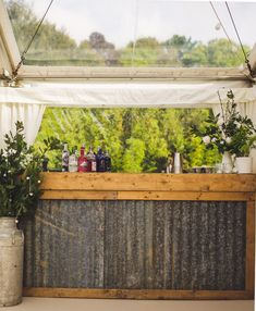 How about a rustic bar for your wedding marquee? This is ours, made from corrugated sheets and rustic wooden boards. It looks fantastic and… – rustic