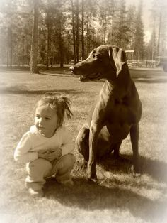 A little girl and her best bud.
