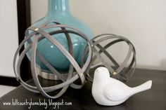Hill Country Homebody: Sphere Not! DIY for these spheres... Future atom for boy/science themed room.
