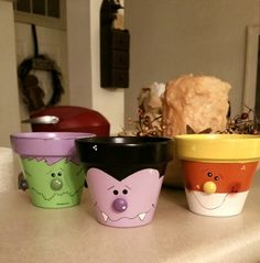 I painted these clay pots for Halloween!