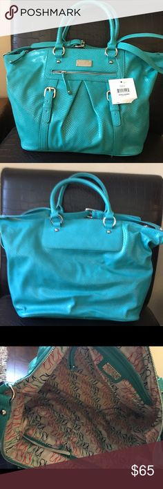 """Nine West blue handbag Brand new bag with tags , inside has one zip and two slip pockets. Top zip closure. Comes with long strap also which is attached to bag. Top width is 19"""" and bottom width is 13"""" . Height is 12"""" . Nine West Bags Satchels"""