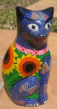 Ceramic Cat in Blue, Marguerite DeJesus (Mexico, 2007). I have a very similar cat (with a kitten) I bought here in Argentina. Just lovely.