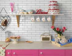 Microline White gloss Topps Tiles with the pink cabinets and retro accessories LOVE