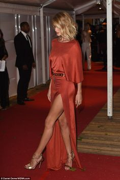 Best leg forward: Model and actress Rosie Huntington-Whiteley showed off her amazing body and her metallic heels in her statement dress as she attended the Glamour Women Of The Year Awards on Tuesday night