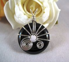 Silver and black onyx donut bead pendant by GemfireWire on Etsy