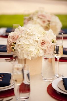 I love the dark blue which reminds me of a nautical style, with the classical hydrangea and rose centerpieces:)