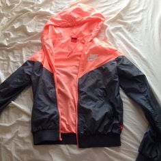 Coral and grey Nike windbreaker price always negotiable only through offer button payment only through posh  •  •  •  •  •  •  •  •  •  •  •  •  •  •  •                   The coloring is slightly off, it's not as orange as shown in the pictures. More of a hot pink/coral color. This thing is so cute and my arms are too long for it so I've only worn it a few times! Perfect condition! Nike Jackets & Coats