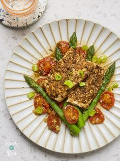 Tender cod fillets with Cajun spices, cooked together with juicy cherry tomatoes and crisp asparagus. Slimming friendly, fresh and flavourful! Clean Eating Recipes, Cooking Recipes, Healthy Recipes, Healthy Meals, Yummy Recipes, Baked Cod, Baked Fish, Cajun Spice Mix, Cherry Tomato Recipes