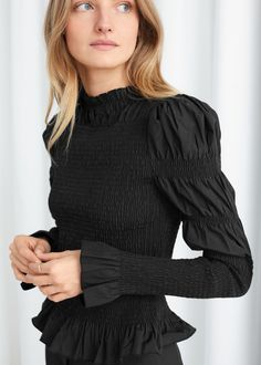 Structured fitted blouse with puff sleeves and intricate smock panel detailing across bodice and sleeves.Flared ruffles at neck, cuffs and hemCotton blendLength of blouse: / wears: EU 36 / UK 10 / US 4 / Small Model height: / Punto Smok, Nye Outfits, Sweaters And Jeans, Fashion Sale, Knit Skirt, Fashion Story, Winter Looks, Who What Wear, Smocking