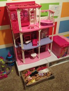 plastic storage drawers under the barbie dream house...so smart!!!