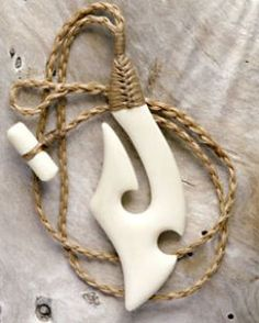 Maori symbol necklace with traditional binding
