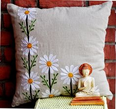 Daisy cushion Lovely white daisies on a pure organic linen  Ribbon work handcraft. You can feel the solitude, charm and yang energy that it brings to you. Artistically thought of by our designers, complimented equally by the gifted craftsmen,  a unique beautiful fusion of art and style.